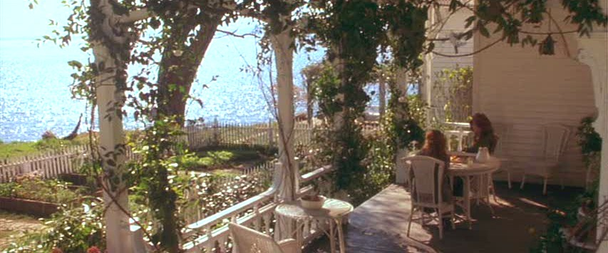 Practical-Magic-house-side-porch-overlooking-the-water